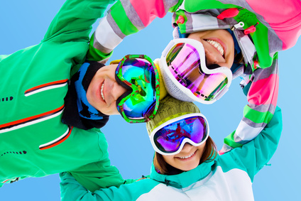 cheerful young friends in winter sportswear ski resort