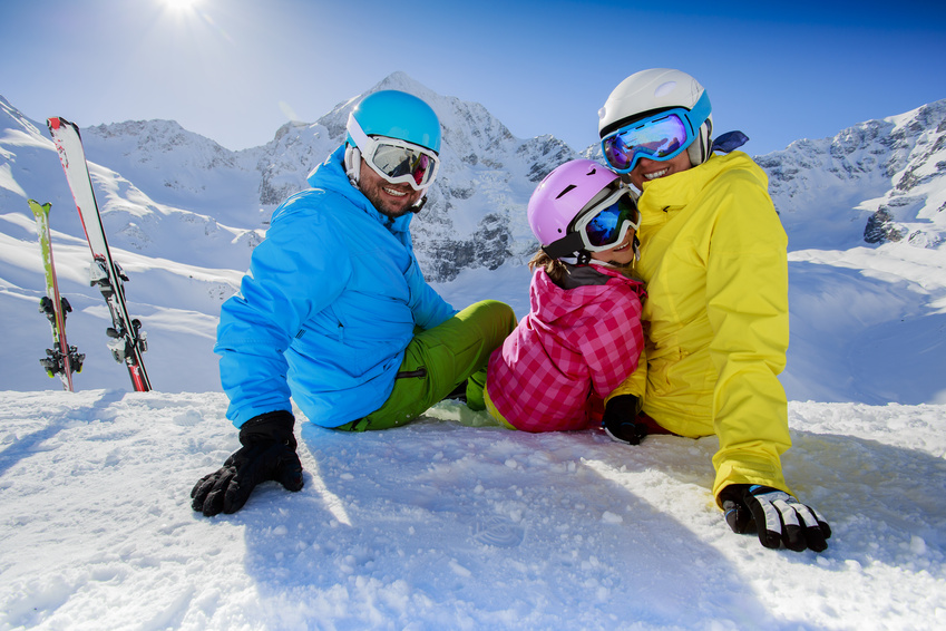 Skiing, winter, snow, skiers, sun and fun - family enjoying winter vacations